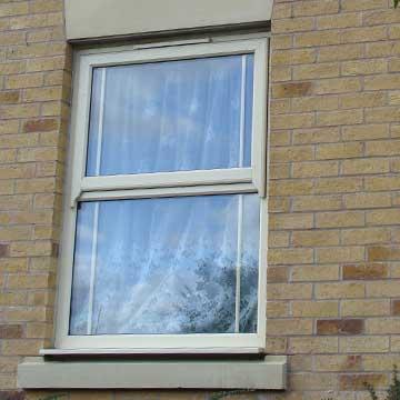 Cream coloured sash window installation