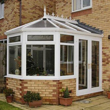 Victorian conservatory with glass roof- summer offers