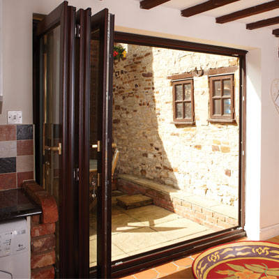 Bifold doors win dor for Brown upvc door