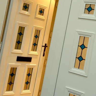 White front door with decorative glass panels