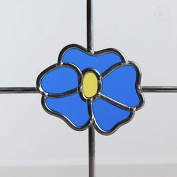 Decorative glass with blue flower