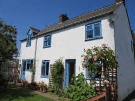 Unique blue coloured uPVC windows in cottage - double glazing