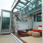Reverse lean-to conservatory with bifolding doors