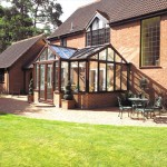 Brown T-shaped conservatory with uPVC frames