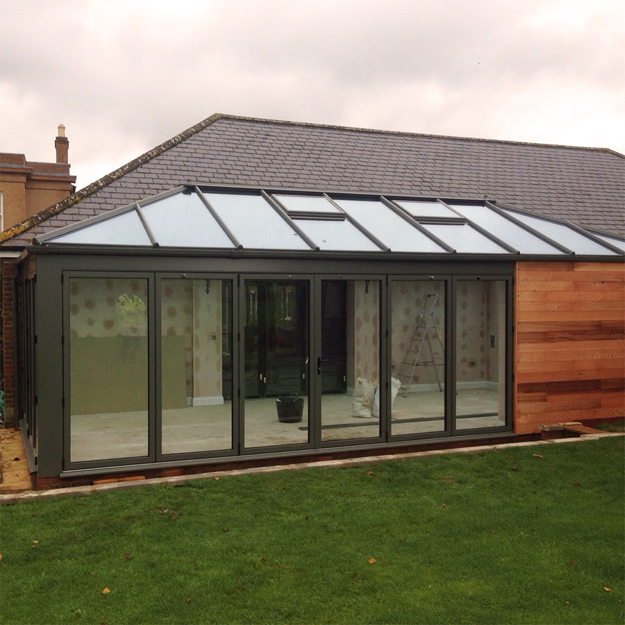 Green glazed extension with timber cladding