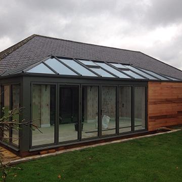 Grey framed glass front conservatory