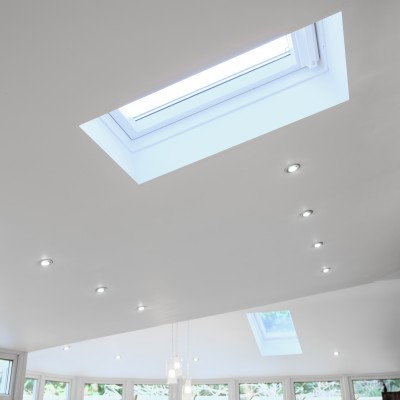 Insulated, solid conservatory roof with roof window