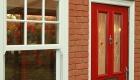 Red composite door in a double glazing showroom in Northampton