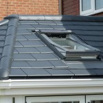 Grey slate tiled roof conservatory with roof window