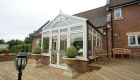 Grey uPVC framed reverse lean-to conservatory