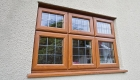 Golden oak coloured window home installation