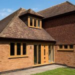 English oak coloured windows house installation