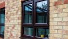 Double glazed window dark wood finish