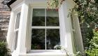 White uPVC sash bay windows