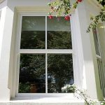 White uPVC sash bay windows