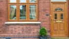Golden oak entrance door upvc installation