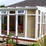 White PVCu Lean To Conservatory bungalow installation