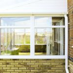 White PVCu Lean To Conservatory house installation
