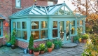 A chartwell green Orangery in an autumn garden