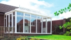 White uPVC Victorian Conservatory in a sunny garden