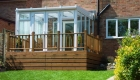 Lean to conservatory white decking garden