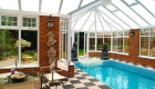 P-shaped conservatory swimming pool