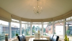 Solid roof conservatory interior dining room