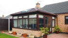 Solid roof conservatory rose wood